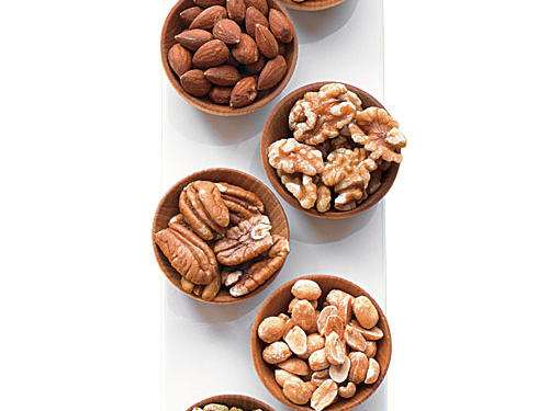 Snacks can be a strategic way to keep your appetite in check if they have the right ingredients. Trouble is, standard snack foods like highly processed chips or crackers rarely satisfy, making it frighteningly easy to plow through hundreds of calories before your hunger gauge hits full. Not so with nuts. Naturally packed with a gratifying trio of fiber, protein, and healthy fat, nuts can be a super smart nibble. Just be sure to limit portions to 1 ounce or less to keep calories under control. That's about 14 walnut halves, 22 almonds or 49 pistachios. Try making your own snack mix with different nut varieties and some spicy pepper!