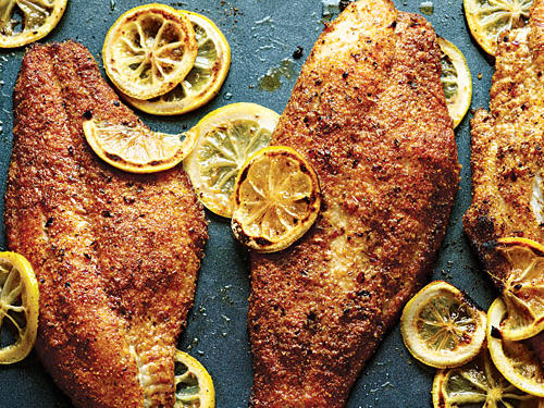 The spicy cornmeal breading stays crispy when the fish is baked on a ventilated broiler pan. You can also use yellow cornmeal. Try this breading on other white fish fillets.
