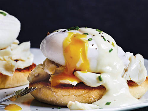 A mock hollandaise sauce, made from mayonnaise and buttermilk, replaces the traditional clarified butter. Big chunks of sweet lump crabmeat drenched in creamy egg yolk are a welcome, fancier change from the traditional Canadian bacon. Serve with steamed asparagus.