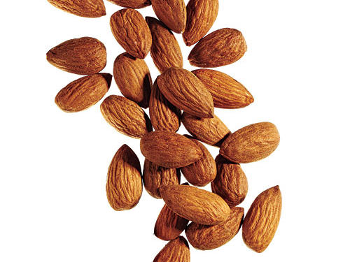 If you want a quick snack before bed that doesn't require any prep work, grab a handful of almonds. They're a rich source of the sleep-supporting amino acid tryptophan, as well as the nutrient magnesium, a natural muscle relaxer. Plus, the protein in almonds will keep you full all night. Keep a simple trail mix recipe of almonds, dried tart cherries, toasted coconut flakes, and sunflower seeds on hand for a sleep-enhancing snack.