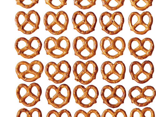 Thanks to a lingering effect of the 90s fat-free craze, many regard pretzels as a healthy snack option. But, there's not much to say about pretzels nutritionally that make them a good snack choice. Usually made from refined flour, pretzels are low in calories, but also low in protein, fiber, fat, vitamins and minerals, which is why you still feel pretty hungry after eating them. Plus, pretzels are typically high in sodium. If you're craving a salty crunch, opt instead for a snack with a little fiber and protein to provide satiety and nutrients, such as a handful of nuts, hummus with baby carrots, or apple slices with cheese cubes.