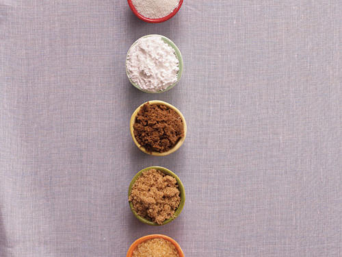 From top to bottom: Granulated sugar, powdered sugar, dark brown sugar, light brown sugar, turbinado sugar.