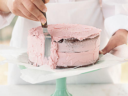 For the sides, load the spatula with frosting, and lightly push into the cake as you turn the cake stand. Continue spreading until the cake is evenly coated. Let the cake set in the refrigerator for 15 minutes before decorating it.