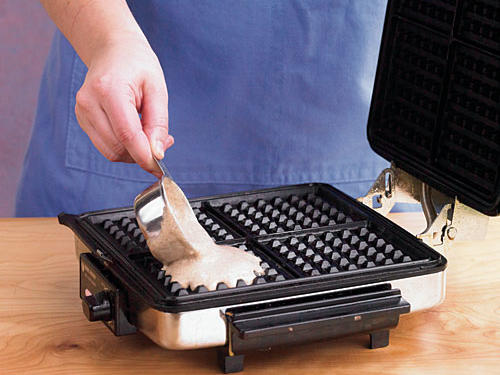For a 4-inch waffle iron, pour about 1⁄3 cup batter onto the hot waffle iron. Belgian waffle makers require more batter to fill them out.