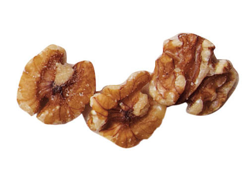 """While most varieties of nuts boast health benefits, the unique fat make-up of walnuts makes them particularly helpful when it comes to lowering cholesterol. Rich in polyunsaturated fats and the only nut source of plant-based omega-3 fatty acids, walnuts are a star food for cardiovascular health. Harvard researchers found that adding walnuts to the daily diet, even for the short term, creates dramatic drops in cholesterol. Study participants averaged a 10-point drop in total cholesterol and a nine-point drop in LDL, or the """"bad"""" cholesterol.How much is good? Although some studies test larger amounts, a handful a day, or about one ounce is a beneficial amount.See More: Healthy Nuts: An A-Z Guide"""