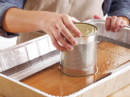 You'll need to soak the plank before using it to help keep the fish moist. A soaked plank also produces maximum smoke and is less likely to burn. Submerge it in water for at least 1 hour. Use the soaked plank right away since the wood will start to dry out.