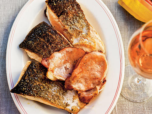 Skin-on fish holds together better on the grill—plus the skin gets deliciously crisp and lightly charred. The recipe traditionally uses Australian bacon, called bacon rashers or back bacon. Because that's less available in the States, we recommend Canadian bacon.