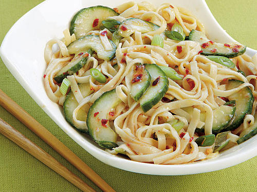 Fresh cucumbers and a sweet-and-spicy sauce coat tender linguine for a gourmet fare that won't cost you a fortune.