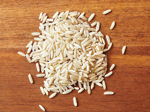 This is rice that has been hulled with bran intact. The bran lends chewy texture and nutty flavor. It requires a longer cooking time because the bran is a barrier to water. But, it keeps more nutrition content intact, and is higher in certain vitamins and minerals than white rice. Since the storage life of brown rice can be 6 months or more, keep a bag handy for quick meals. Brown rice is great for making veggie burgers, rice salads, and international dishes, such as this healthy Asian dish.