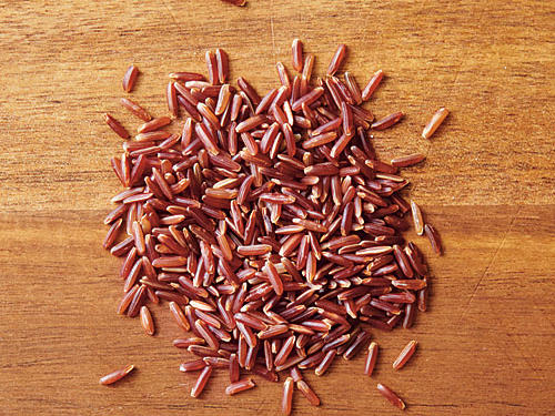 This aromatic rice with reddish-brown bran has a nutty flavor and a chewy consistency.  Look for it in specialty markets. Red rice is great with hearty ingredients like pork or butternut squash.
