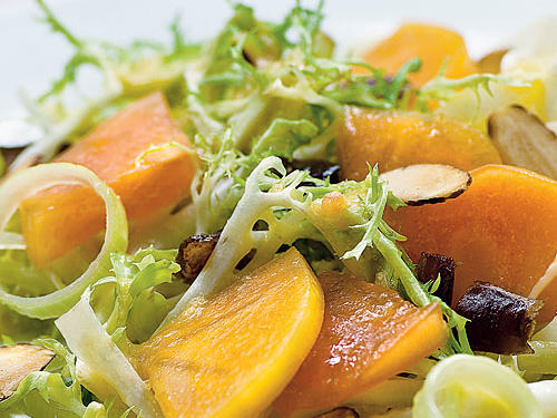 Try this combo of bitter greens and sweet fruit for a summer treat that will leave your taste buds delighted. Choose squat, round Fuyu persimmons for salads; they are crisp when ripe and hold up well for slicing.
