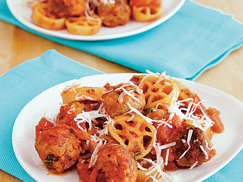 Put a twist on classic spaghetti and meatballs with this to-die-for dish. Turkey meatballs and fun wagon wheel pasta sprinkled with fresh Parmesan cheese is the perfect combination for any pasta lover.