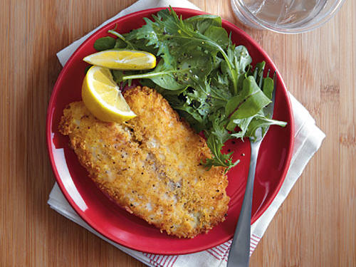 Dip the fish in the eggs and then into the panko mixture.