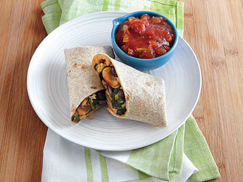 These burritos are so flavorful and simple to make. Lunch comes together in 20 minutes. The spinach-mushroom filling is packed with healthy ingredients, but the ooey-gooey cheese is what sells kids on this combo.