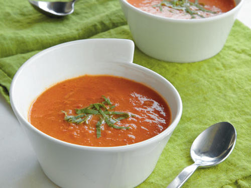 This tomato soup is no sugary version out of a can. Top with a little cream, and serve with Parmesan Crisps to round out your meal. Make this a vegetarian option by using vegetable broth instead of chicken broth.