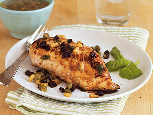 Pine nuts and currants create the perfect tasty combination of flavor to drench atop this chicken. Serve with couscous to add even more.
