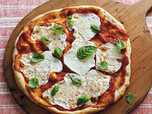 With a make-ahead dough and a simple sauce, this pizza is an option any night of the week. Just make the dough in the morning; then shape it an hour before you're ready to eat. If homemade dough is not your thing, just buy the premade dough at Trader Joe's or Whole Foods Market and shape it as you would the scratch dough.