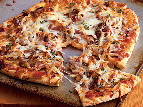 Top your pizza with the sauce, prosciutto, onions, and cheese. This pizza is the perfect dish for a dinner party.