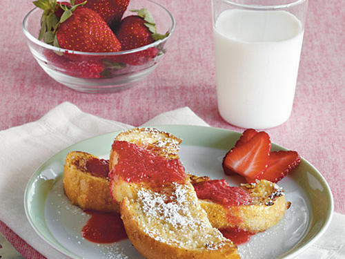 "French toast doesn't have to be a junky breakfast. In fact, with the protein from the eggs and some fresh strawberries, it can be an energizing start to the day. Serve a small amount of syrup on the side if you want to control how much sugar your kids are getting. They'll love dipping the ""soldiers"" into the syrup."