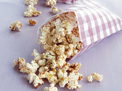 Try and buy popcorn with no added ingredients−Whole Foods is a good example. Sprinkle the cinnamon-sugar mixture on top; it's a yummy treat.