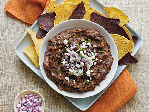 Bean dips are full of protein and fiber to help you get through the afternoon. Serve this dip with baked tortilla chips,