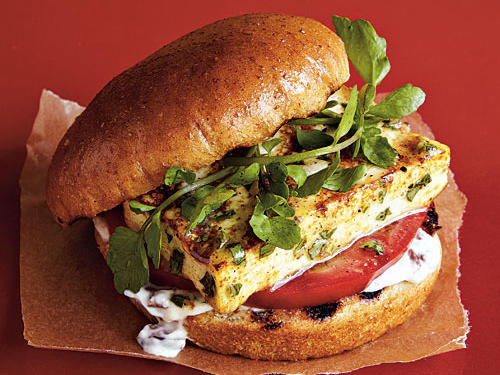 Marinated tofu slices acquire a golden crust when grilled; the olive-garlic mayonnaise on the sandwich adds a Mediterranean flavor. Serve with grilled asparagus for a simple side.