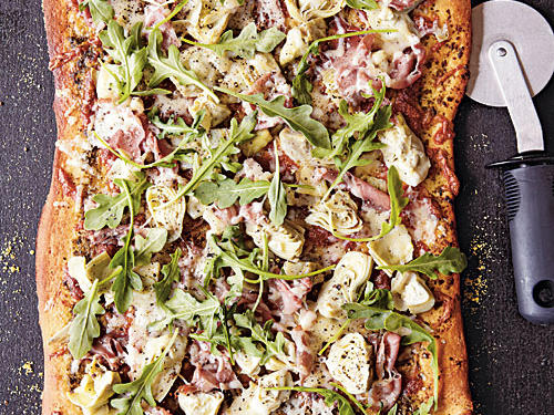 With artichokes, arugula, pesto, prosciutto, and Parmesan, this pizza has intense, addictive flavor. Splurge and try it with homemade pesto.