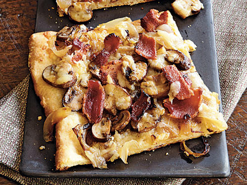 Add bacon to anything and it becomes instantly irresistable–like this pizza. The refrigerated French bread dough used as the crust is quick, but it's also delicate. To work with it, find the seam in the dough and carefully unroll.