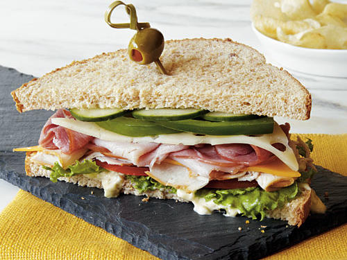 A Dagwood sandwich, popularized by the comic strip character Dagwood Bumstead, is characterized by layers of sodium and fat-laden meats and cheeses. We've slimmed ours down by using no-salt-added and lower-sodium deli meats and lower-fat cheeses held together with a tasty homemade spread.