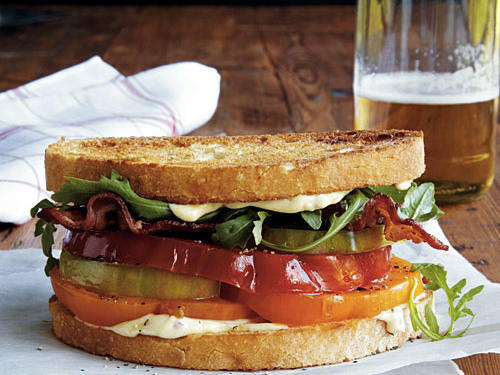Try a slightly new interpretation of the classic BLT with a flavored mayo. You can prepare the mayonnaise mixture and cook the bacon up to one day ahead.