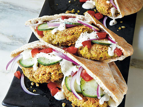 This traditional Middle-Eastern meal is a healthy and hearty choice for lunch or a heavier snack. The tahini-yogurt sauce drizzled overtop the falafel and the veggies adds a creamy texture and appetizing flavor.