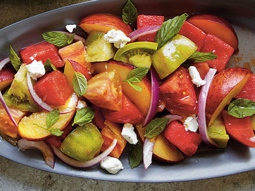 This summer salad features seasonal tomatoes, watermelon, and peaches to create a sensationally delicious side dish that's appropriate for any occasion.