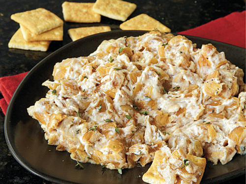 Forget the boxed mixes and chilled store-bought versions: This warm onion dip is on a deliciously different level. Serve it with hearty crackers or slices of French bread.