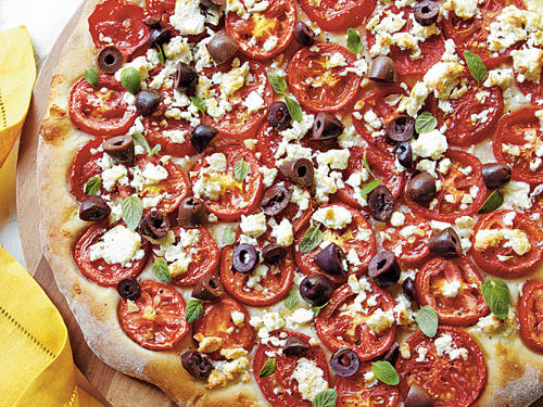 This pizza is fresh, tasty, and a clear winner if you are a big fan of tomatoes and cheese. If olives are a deal breaker, leave them off; the pizza is still yummy.