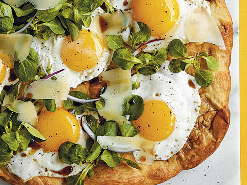 Enjoy your eggs sunny-side up on a pizza that bears the same name. Mâche, red onion, and Parmesan cheese join these savory eggs for an outstanding, savory Sunny-Side-Up Pizza that's perfect for brunch or a light supper.