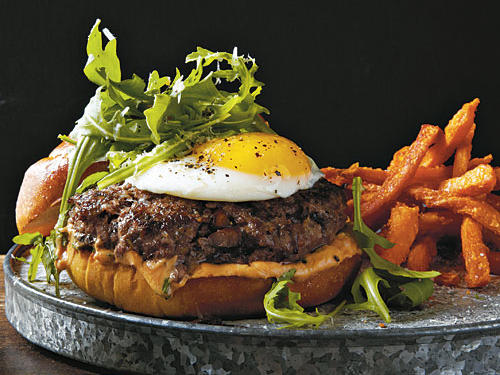 Between the beef, egg, cheese, mushrooms, and truffle oil, this burger is an absolute umami bomb, exploding with meaty, savory flavor. Chopped, sautéed mushrooms in the burger mixture add low-fat moisture to the lean beef as it cooks.