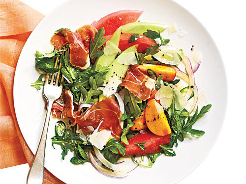 Salty cheese and ham accent the sweet fruit in this refreshing main-dish salad, a perfect meal on a warm spring day.