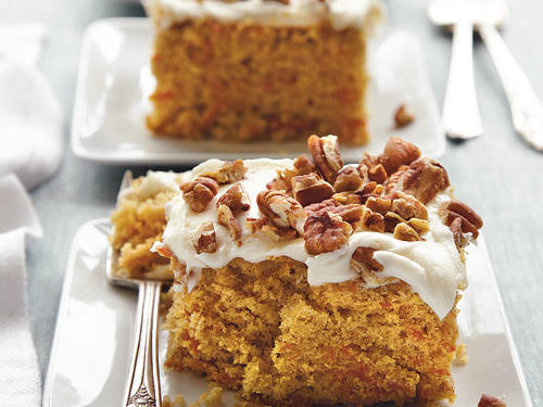 Warm spices and brown sugar enhance the rich, caramelized flavors of carrot cake. Buttermilk and less butter help lighten the still tender cake, creating room for real cream cheese frosting.