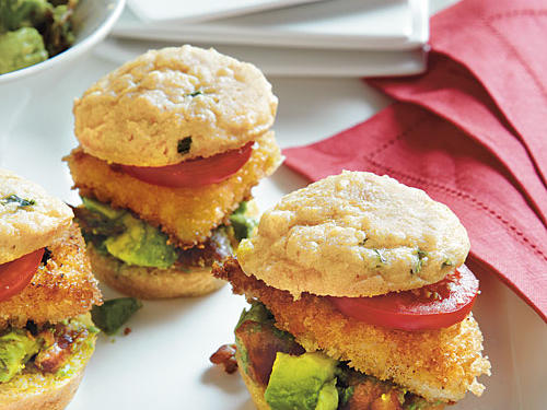 With homemade muffins, a crispy panko topping, fresh guacamole, and crispy bacon, you've got to try these fun and flavorful chicken sliders.