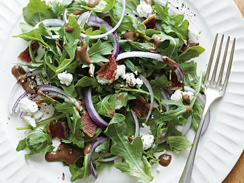 If you're lucky enough to harvest or happen upon the freshest of arugula greens, you'll want to eat an entire salad of them. The sweet figs in the balsamic dressing and the tangy goat cheese are a strong pairing with the peppery greens and the salty bite of bacon. Make the dressing up to three days ahead, and refrigerate. This will be your go-to green salad in season.