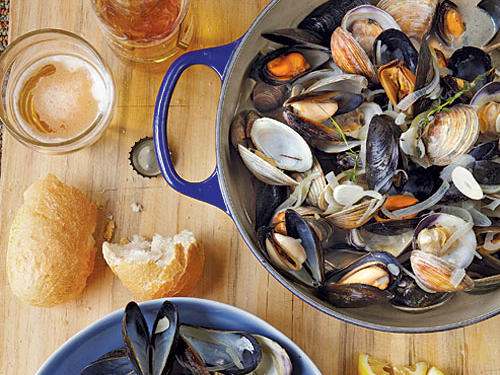 Be sure to use a large, wide pot so the shellfish can cook evenly, then serve them straight from the pot with crusty Italian bread to soak up the broth.