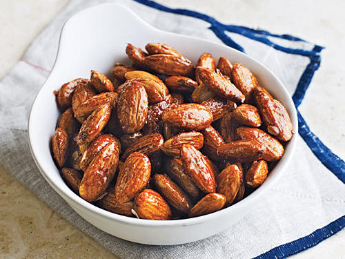 Spiced nuts are usually slowly baked; this stovetop version speeds up the process. The smoky-spicy snack will store well in an airtight container for several days.