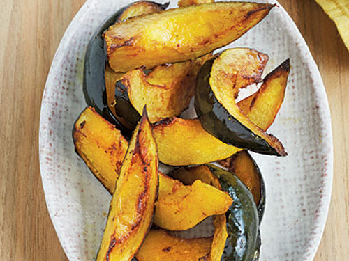 From state to state and coast to coast, all sorts of vegetables make their way to the dinner table. Mix up your own veggie routine by shopping farmers' markets for the fresh and unique produce from your area.Roasted Acorn Squash is a favorite in the Northeast.Preheat oven to 400°. Cut 1 acorn squash in half lengthwise; discard seeds. Cut each half into 6 wedges. Melt 2 tablespoons butter in a large ovenproof skillet over medium heat. Add squash; cook 3 minutes or until browned on each side. Turn wedges; sprinkle with 1/4 teaspoon salt. Place pan in oven; bake at 400° for 12 minutes or until tender.SERVES 4 (serving size: 3 wedges)CALORIES 94; FAT 5.9g (sat 3.7g); SODIUM 192mg