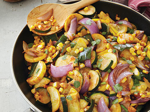 "This Southwestern summer squash mixture is a popular side dish throughout New Mexico and south Texas. Calabacitas means ""little squash"" in Spanish. Tuck it into tortillas for a vegetarian taco or add pork or chicken to make it a main."