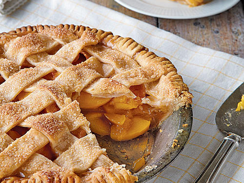 Peach pie isn't that difficult to make in the summer, especially when you use a store-bought crust instead of one that's homemade. Make the process even quicker by adding peaches with the skins on, lending their bright color to the pie. And on a beautiful summer day, wouldn't you rather skip the step that has you standing over a pot of steaming hot water blanching peaches to remove their skins?