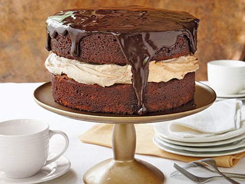 Chocolate lovers rejoice! This rich cake gives you a hit of chocolate in each element—the batter, filling, and glaze. And three kinds of chocolate are used: cocoa, bittersweet chocolate, and milk chocolate.