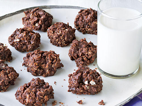 No-bake cookies make even the most oven-shy baker look like a hero. You'll see them at bake sales, fundraisers, and in millions of homes across the country as an after-school snack. We've cut out a lot of the unnecessary butter and added chocolate chips, providing firmness, texture, and a great gloss to these cookies.