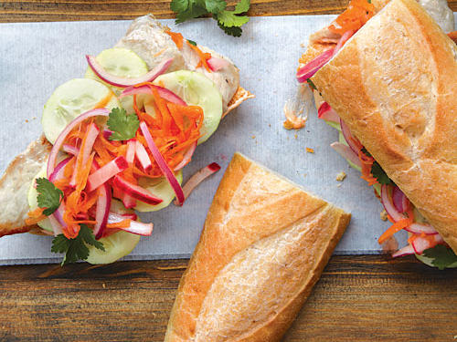 Although the bánh mì may have originated in the markets of Saigon, in bigger cities in the U.S. it is now as much of an American lunchtime staple as the burrito or panini. There are as many variations of the bánh mì as there are cooks who make it. This version combines pork, cucumber, and a pickled slaw of radish, carrot, and onion.