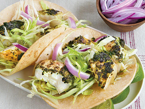 In Southern California, fish tacos often feature fillets that are grilled and then flaked into pieces, rather than breaded and fried as in other regional preparations. We prefer grilling—it saves about half the calories and delivers a fresher fish flavor. If wild-caught Alaskan halibut is not available, substitute striped bass or U.S. line-caught cod.
