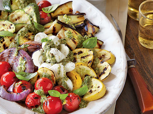 The original Caprese salad consists of mozzarella, tomato, and basil, but our take adds grilled vegetables and homemade pesto for a hearty twist.